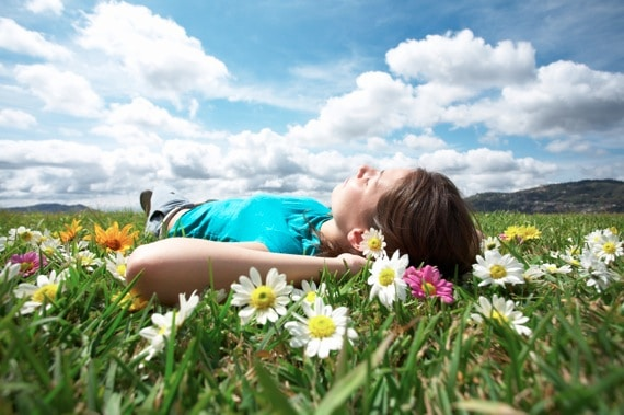 Woman Lying in a Field Dreaming - Photo courtesy of ©iStockphoto.com/ALEAIMAGE, Image #5724729