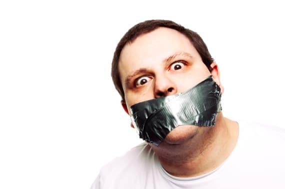 Man with His Mouth Taped Shut - Photo courtesy of ©iStockphoto.com/Spauln, Image #8128745