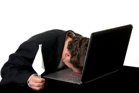A Man with His Head on His Laptop and a White Flag of Surrender - - Photo courtesy of ©iStockphoto.com/Captainflash, Image #9029390