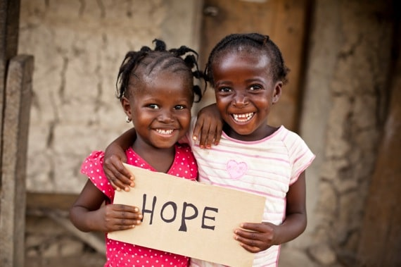 Two African Children Holding Up a Hope Sign - Photo courtesy of ©iStockphoto.com/MShep2, Image #13551372