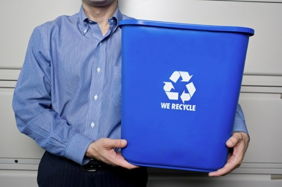 Business Man Holding a Blue Recycling Bin - Photo courtesy of ©iStockphoto.com/michellegibson, Image #14239405