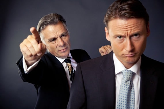 A Businessman Firing a Colleague - Photo courtesy of ©iStockphoto.com/nullplus, Image #10081269