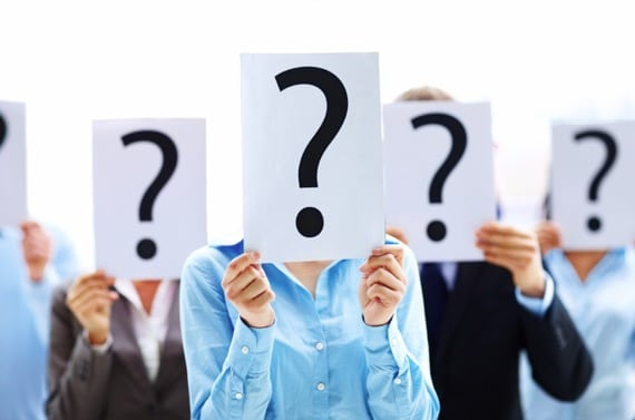 Business People Holding Question Mark Signs in Front of Their Caces - Photo courtesy of ©iStockphoto.com/Yuri_Arcurs, Image #11860969