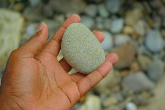 A Stone in a Hand - Photo courtesy of ©iStockphoto.com/jaminwell, Image #12120864