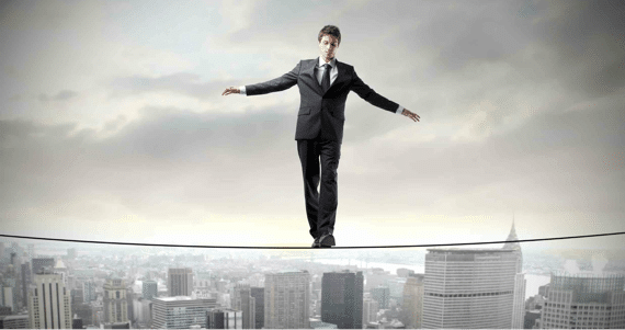 A Business Person Trying to Maintain His Balance - Photo courtesy of ©iStockphoto.com/bowie15, Image #13200637