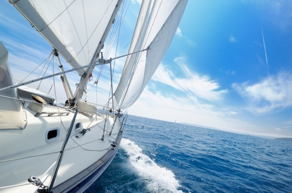 White Sails of a Yacht Billowing in the Wind - Photo courtesy of ©iStockphoto.com/nikitje, Image #14618329