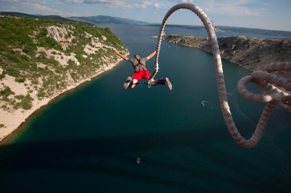 A Man Jumping with a Bungee Cord - Photo courtesy of ©iStockphoto.com/mayo5, Image #10013408