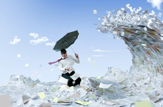 A Man Facing a Huge Wave of Paper - Photo courtesy of ©iStockphoto.com/sekulicn, Image #12153567