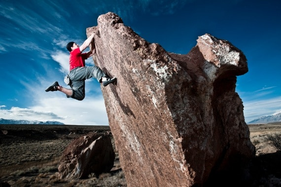 A Man Rock Climbing a Huge Boulder - Photo courtesy of ©iStockphoto.com/vernonwiley, Image #15344162
