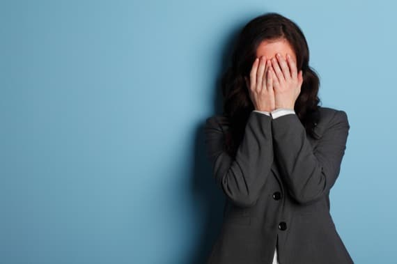 A Distraught Businesswoman with Her Head in Her Hands - Photo courtesy of ©iStockphoto.com/DNY59, Image #15936915
