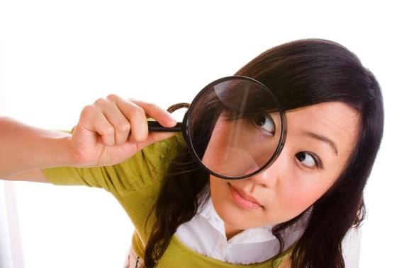 Girl Looking Through a Magnifying Glass - Photo courtesy of ©iStockphoto.com/izusek, Image #3551768