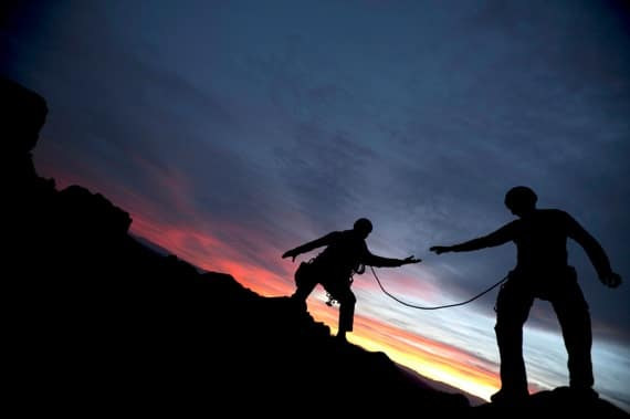 A Climber Reaching Out to Help His Partner - Photo courtesy of ©iStockphoto.com/DOUGBERRY, Image #10526083