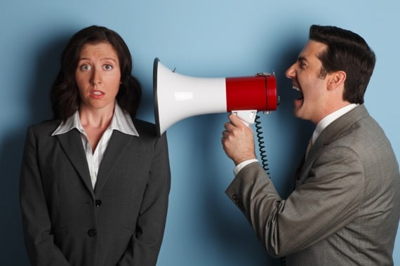 A Businessman Shouting at a Businesswoman Using a Megaphone - Photo courtesy of ©iStockphoto.com/DNY59, Image #15886285