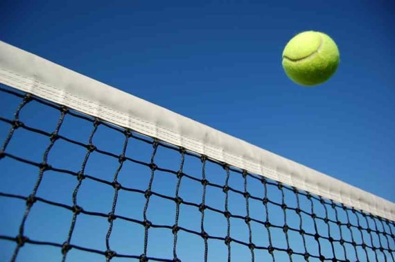Tennis Ball Fying Over the Net Photo courtesy of ©iStockphoto.com/cscredon, Image #2862985