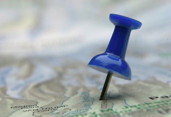 A Thumbtack Pinpointing a Location on a Map - Photo courtesy of ©iStockphoto.com/alephx01, Image #101025