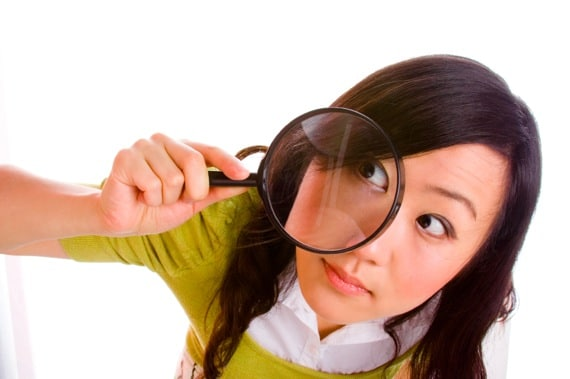 A Woman Looking Through a Magnifying Glass - Photo courtesy of ©iStockphoto.com/izusek, Image #3551768