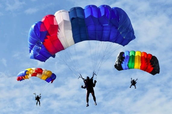 Three Parachuters Landing - Photo courtesy of ©iStockphoto.com/ishoot63, Image #16917968
