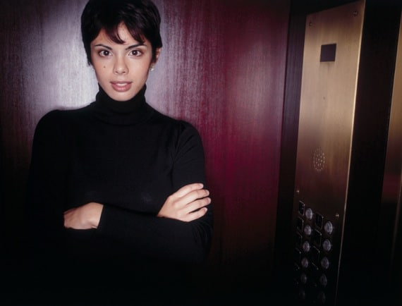 Portrait of a Businesswoman in an Elevator - Photo courtesy of ©iStockphoto.com/PlushStudios, Image #17385865