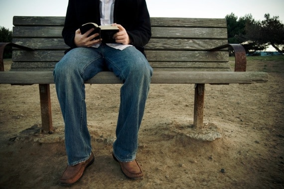 A Man Sitting on a Bench Reading His Bible - Photo courtesy of ©iStockphoto.com/irishblue, Image #4950788
