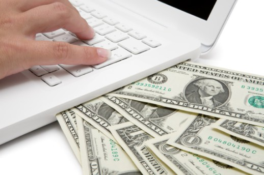 Cash Coming Out of a Computer - Photo courtesy of ©iStockphoto.com/JoKMedia, Image #13923134