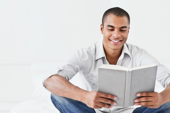 Young Man Reading on His Bed - Photo courtesy of ©iStockphoto.com/Neustockimages, Image #14518282
