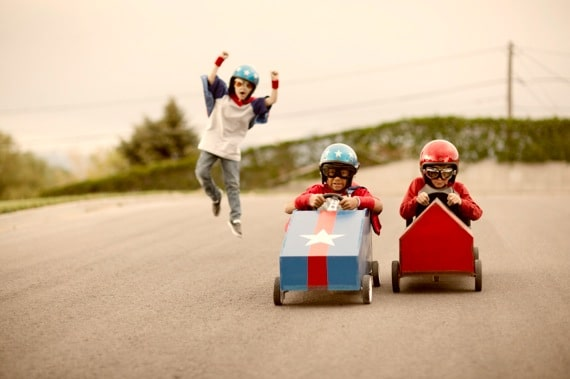 Two Young Boys Racing Their Homemade Cars While Another Cheers Them On - Photo courtesy of ©iStockphoto.com/RichVintage, Image #16717070