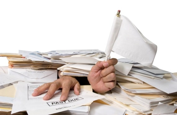Man Buried in Paperwork - Photo courtesy of ©iStockphoto.com/VallarieE, Image #9744255