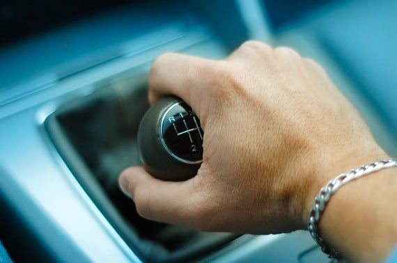 Close Up of a Hand Down Shifting a Manual Transmission - Photo courtesy of ©iStockphoto.com/dtimiraos, Image #4801950