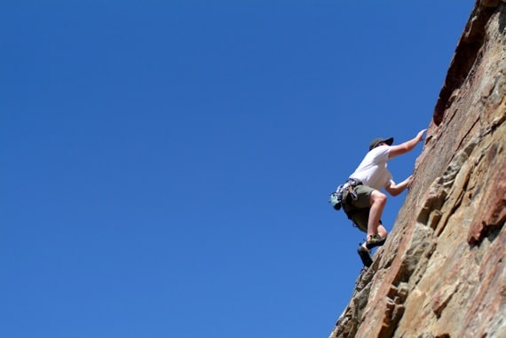A Man Climbing a Rock Wall - Photo courtesy of ©iStockphoto.com/LUGO, Image #1827245