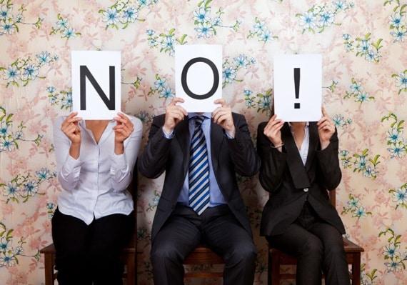 Judges Holding Up a No Sign - Photo courtesy of ©iStockphoto.com/OrangeDukeProductions, Image #17072506