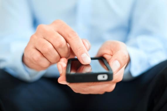 Man Typing into a Smartphone - Photo courtesy of ©iStockphoto.com/TommL, Image #17760721