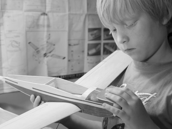 Young Boy Building a Model Airplane - Photo courtesy of ©iStockphoto.com/eriktham, Image #18115686
