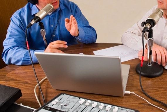 Two Businessmen Recording a Podcast - Photo courtesy of ©iStockphoto.com/eezsnow, Image #3868197