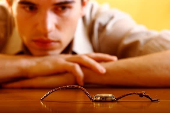 A Man Looking at a Watch on a Table - Photo courtesy of ©iStockphoto.com/Cimmerian, Image #1205738
