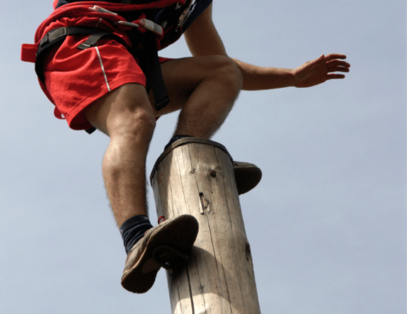 A Man Standing on Top of a Pole - Photo courtesy of ©iStockphoto.com/SLOFotomedia, Image #2939030