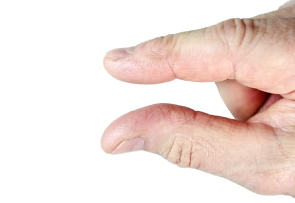 Thumb and Index Finger Indicating Just a Little Bit - Photo courtesy of ©iStockphoto.com/Joe_Potato, Image #5620578