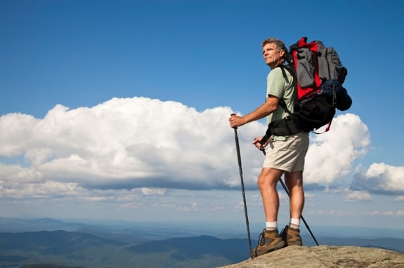 Backpacker on Mountain Summit - Photo courtesy of ©iStockphoto.com/cglade, Image #10473146