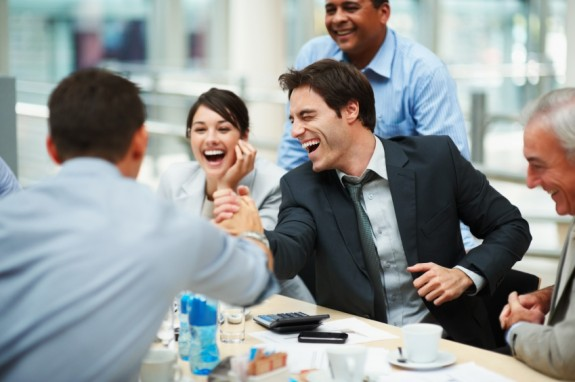 Happy Man with Happy Group - Photo courtesy of ©iStockphoto.com/Yuri_Arcurs, Image #12604968