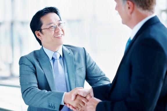 Two Business Executives Shaking Hands - Photo courtesy of ©iStockphoto.com/kupicoo, Image #18859584