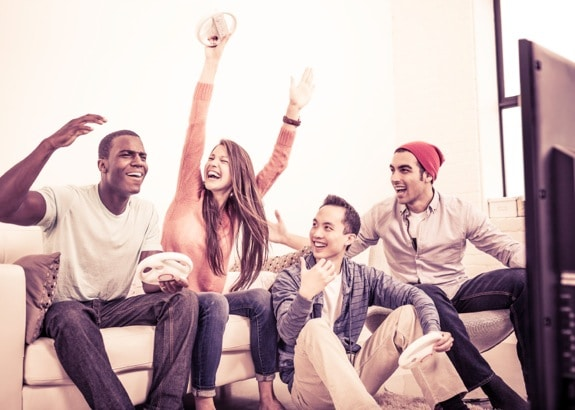 Some Friends Enjoying a Video Game - Photo courtesy of ©iStockphoto.com/ranplett, Image #20557818