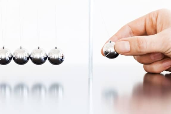 Newton's Cradle with One Ball About to Be Dropped - Photo courtesy of ©iStockphoto.com/TommL, Image #17094436