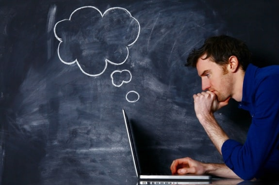 Man with a Laptop Against a Blackboard - Photo courtesy of ©iStockphoto.com/mattjeacock, Image #19460301