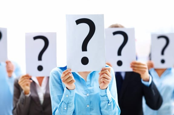 Business colleagues holding question mark signs in front of their faces - Photo courtesy of ©iStockphoto.com/Yuri_Arcurs, Image #11860969