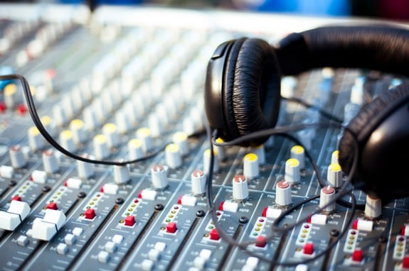 Professional Audio Headphones on a Mixer - Photo courtesy of ©iStockphoto.com/timnewman, Image #14557255