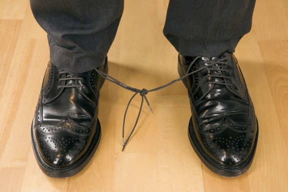 A Man Without His Shoes Tied Together