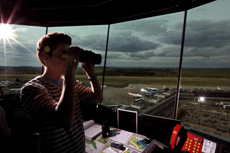 EDINBURGH, UNITED KINGDOM - APRIL 19: Greig Reid an air traffic controller looks from the air traffic control tower at Edinburgh Airport as flights are cancelled for a fifth day on April 19, 2010 in Edinburgh, Scotland. Thousand of holiday makers remain stranded abroad as the ban on flight to and from UK airport because of volcanic dust continues.  (Photo by Jeff J Mitchell/Getty Images)