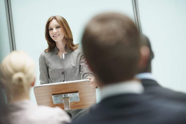 Attractive female speaker presenting during business seminar